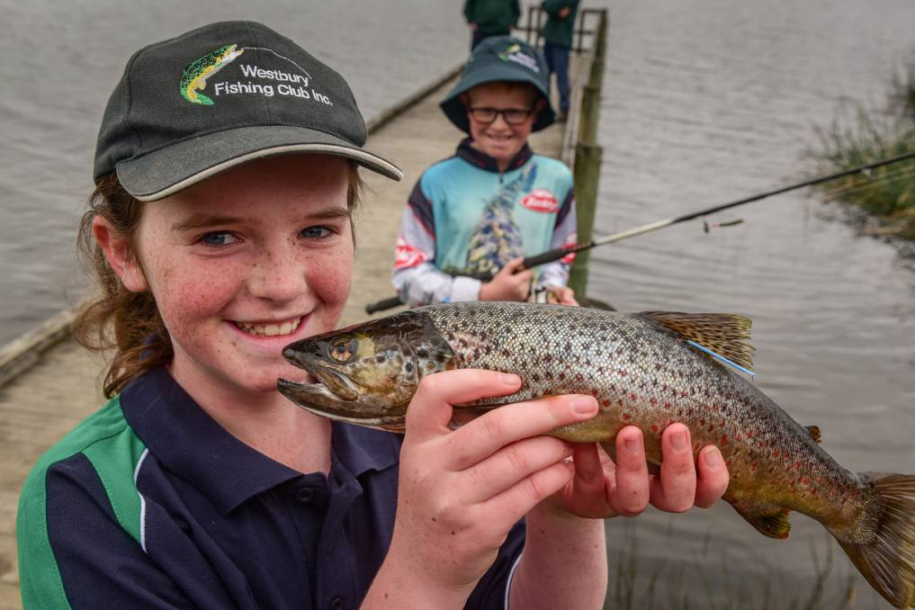 HOOKED: Fiona Batterham was fishing with her family when she caught the first of five $10,000 trout. Photo: Paul Scambler