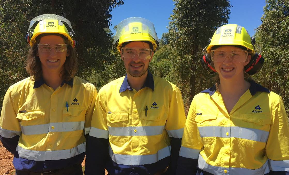 Chemical engineering graduate Brendan Farrell (left) joined Mandurah residents Mason Carr and Mara O'Grady on a tour of Alcoa's Huntly mine site. Photo supplied.
