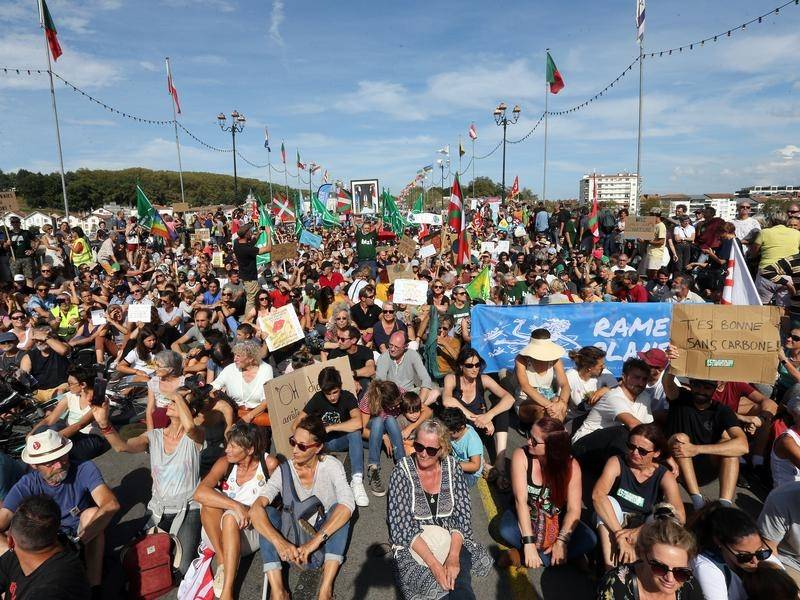 Huge protests have been held across France and in the British port of Dover over climate change.