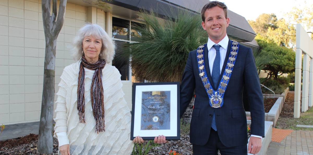 Making Mandurah better: Linda Thorpe receives her award from Mandurah's mayor Rhys Williams. Photo: Supplied.